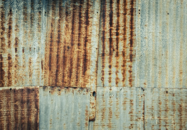 Rusty corrugated metal wall background in vintage filter effect