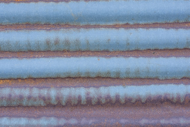 Rusty corrugated metal wall close up background