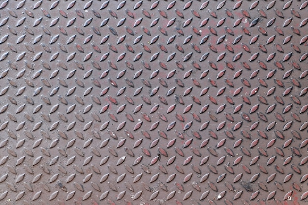 Rusty diamond metal plate texture pattern background