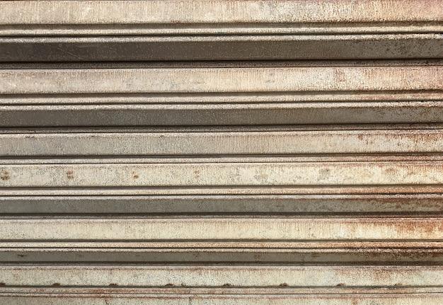 Rusty iron roller shutter, grunge steel iron