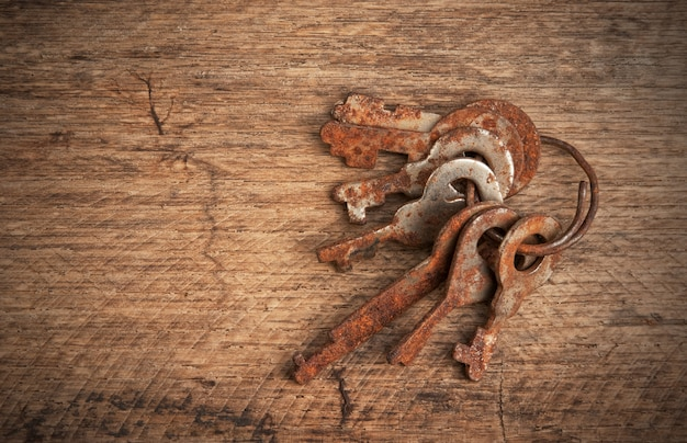 Rusty keys on a wooden board