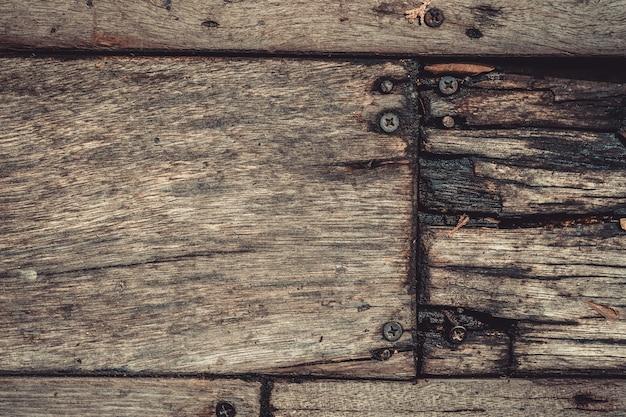 Rusty metal nails on wooden floor