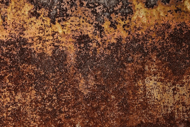 さびた金属板の背景のテクスチャ。錆びた鋼板がほぼ全面を覆っていた。