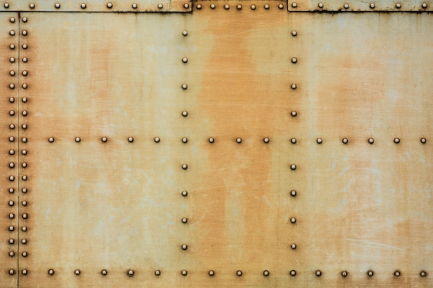 Rusty metal plate with pin texture