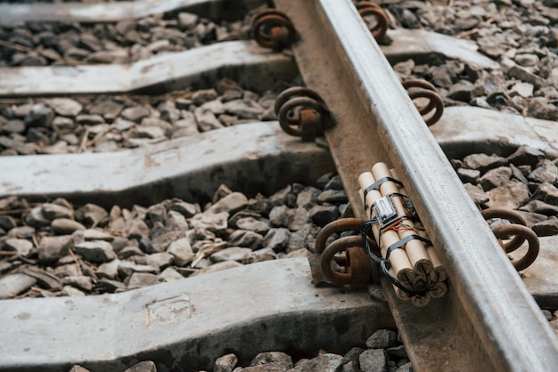 Rusty metal. timebomb on the railway at daytime outdoors. conception of terrorism and danger