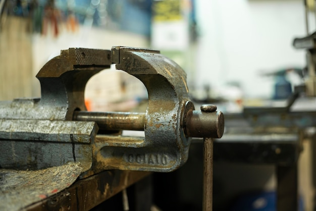 Rusty metal vice on the machine shop bench