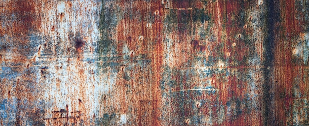 Rusty metal wall, old sheet of iron covered with rust with multi