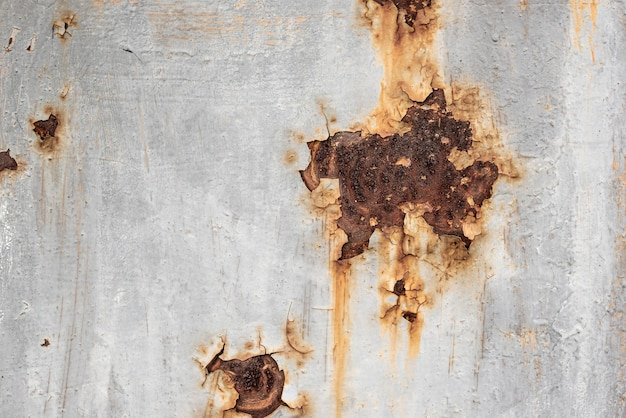 Rusty metallic surface with peeling paint