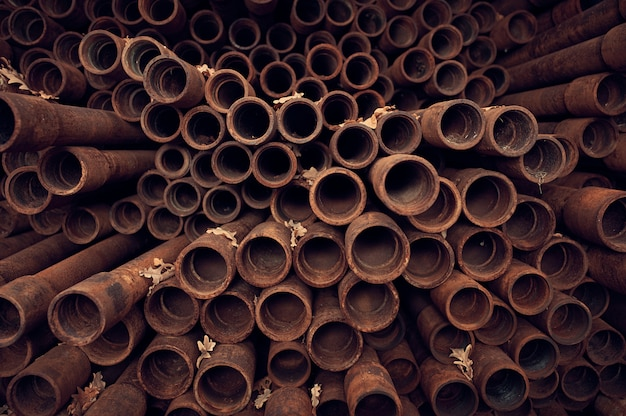 Rusty pipes background. end perspective view. industrial concept.