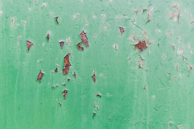Rusty red and scratched green wall