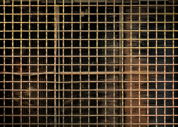 Rusty steel grating at old engine radiator