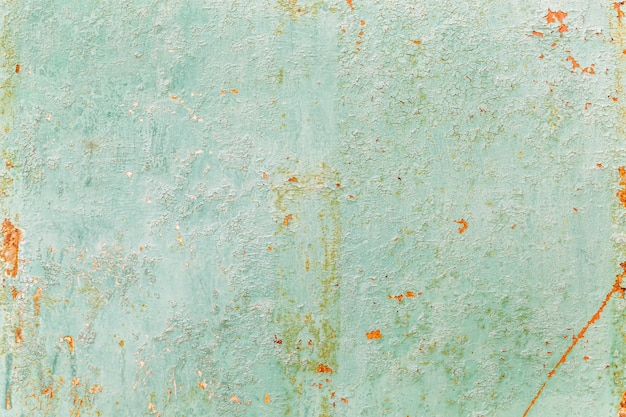 Rusty surface of a turquoise sheet of iron. background. space for text.