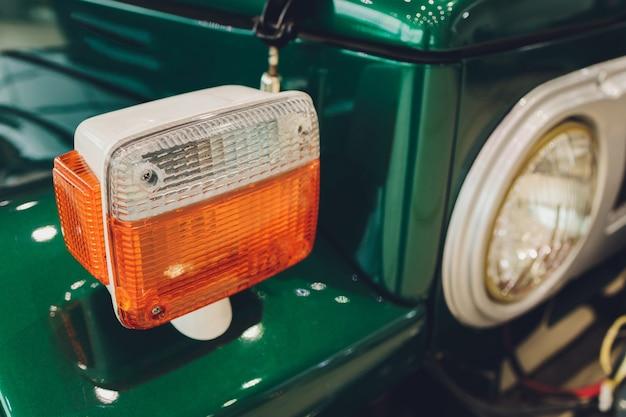 Rusty yellow fog lamp on an old car.
