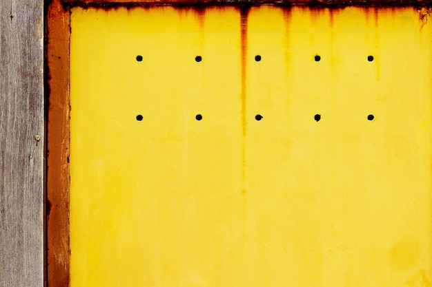 Rusty yellow metal plate texture