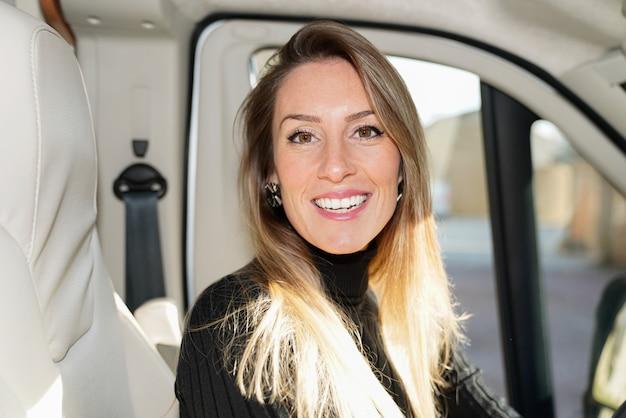 Rv camper van travel woman driving motor home camping car Premium Photo