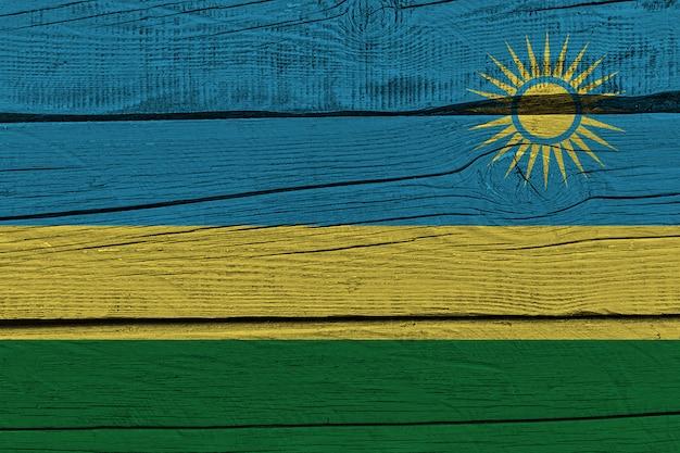 Rwanda flag painted on old wood plank