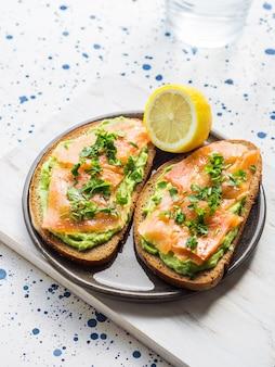 Rye bread avocado toasts with smoked salmon