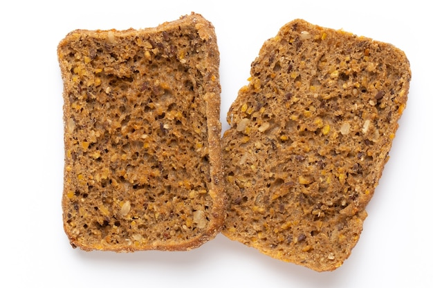 Rye bread slice on a white surface.  flat lay.