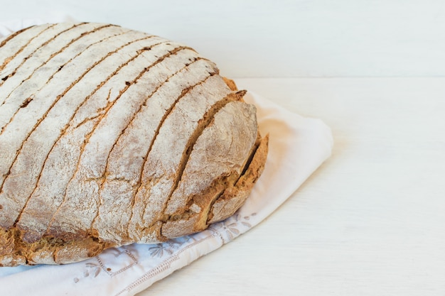 Rye bread sliced with a knife. dark crust and crumb