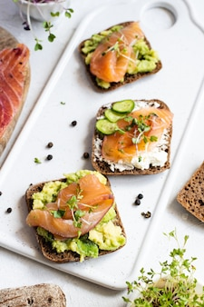 Rye bread, smoked salmon, cucumber and microgreens