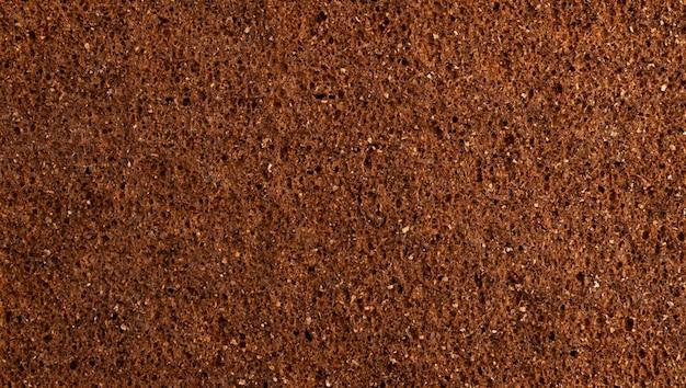 Конец текстуры ржаного хлеба вверх, космос коричневого хлеба