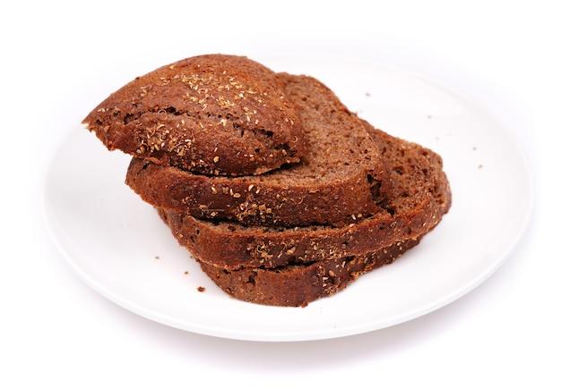 Rye bread on white plate