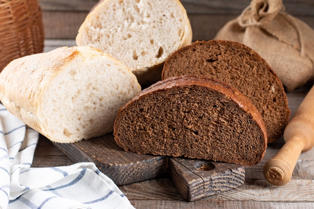 Rye bread and white wheat bread on cutting board