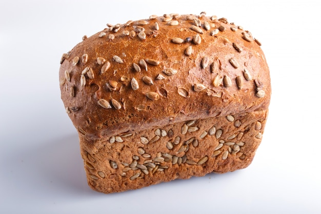 Rye bread with sunflower seeds isolated on white.