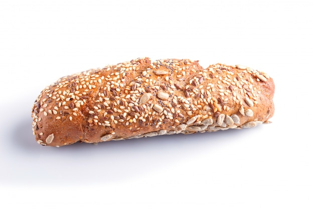 Rye bread with sunflower seeds, sesame and flax isolated on white.