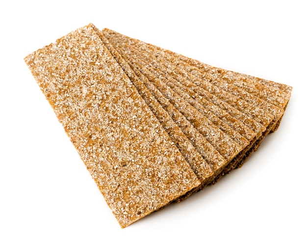 Rye crackers on white, isolated. top view.