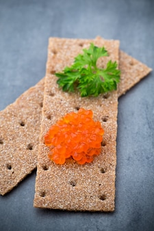 Rye crispbreads with soft cheese with herbs and bacon.