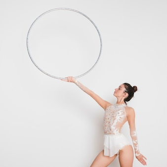 Rythmic gymnast posing with the hoop