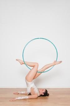 Rythmic gymnast posing with the hoop