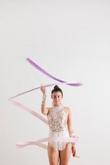 Rythmic gymnast posing with the ribbon