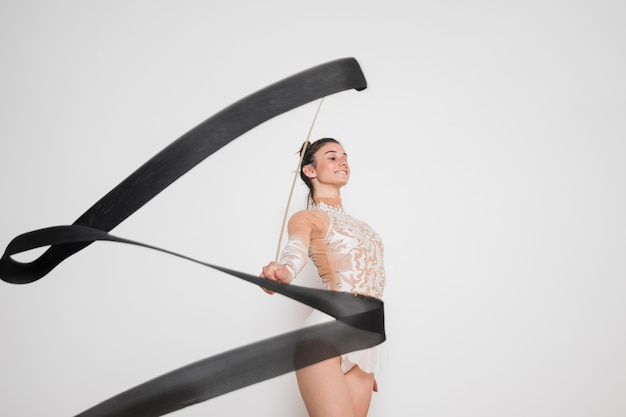 Rythmic gymnast posing with the ribbon