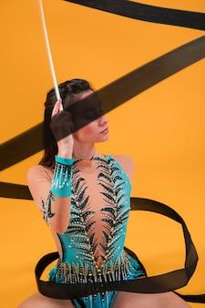 Rythmic gymnast using the ribbon