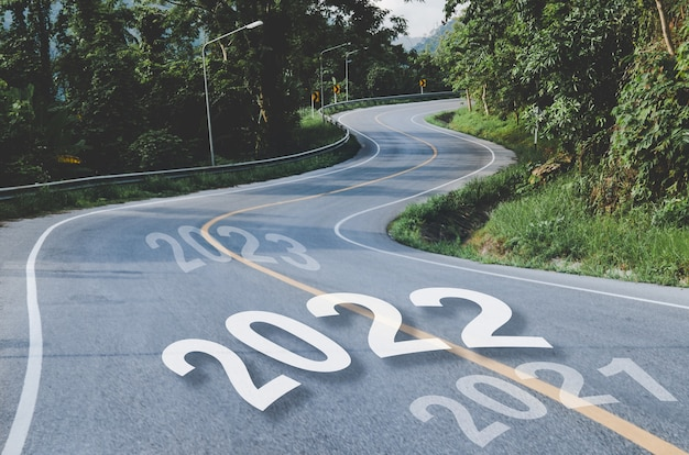 S shape road way in concept of 2021 to 2022 new year, business life goals to successful transportation attitude, path way through the autumnal forest natural way concept