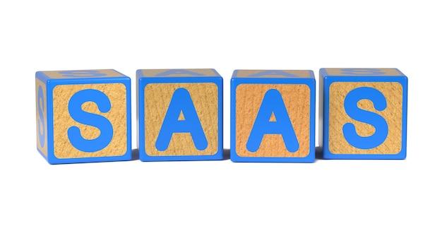 白で隔離される着色された木製の子供のアルファベットブロックのsaas。