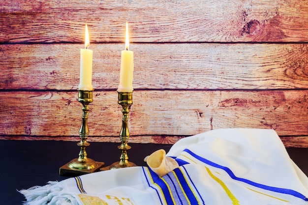 Sabbath. challah bread and candelas on wooden table