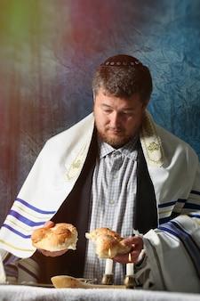Sabbath kiddush, crystal candlesticks with lit candles, and challah challahs