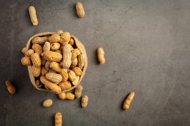 Sack of groundnuts put on dark background