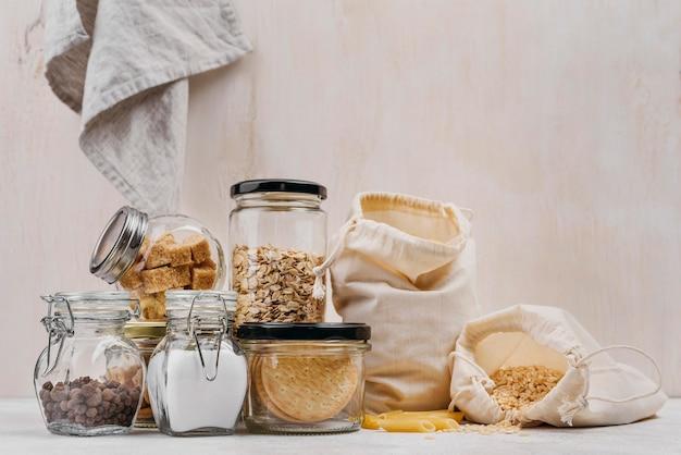 Sack of pasta and ingredients in jars copy space