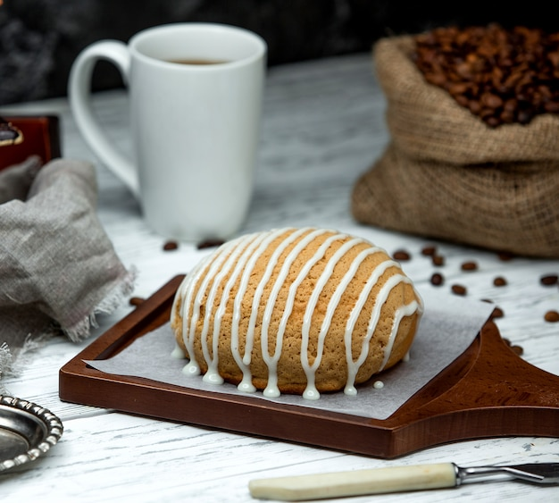 Sack with coffee beans and bread topped with cream