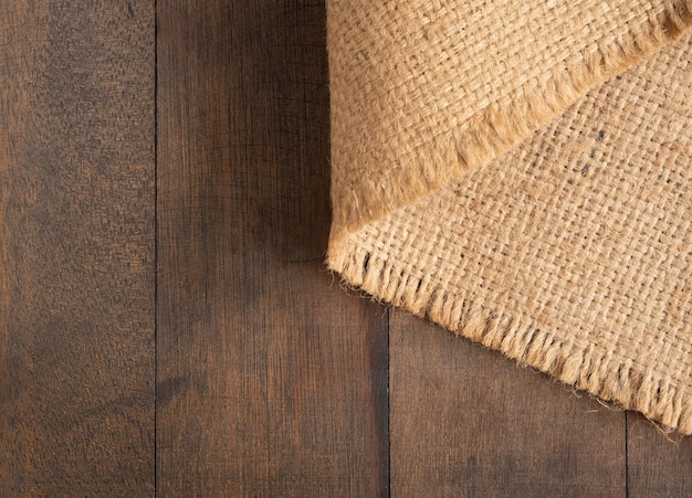 Sackcloth,burlap hessian  arrange on wooden table background  with copy space,top view