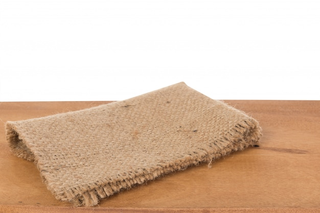 Sackcloth on  wooden background isolated with clipping path