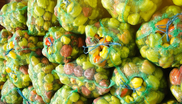 Sacks of fresh bell pepper. eco-friendly products. agriculture and farming. harvest. harvesting.