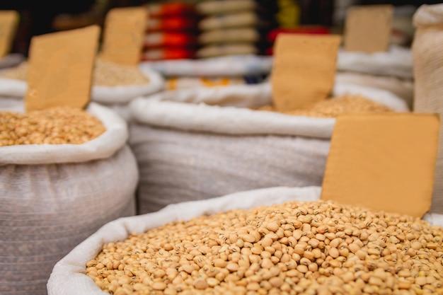 Sacks of white beans in the fair. selective focus.