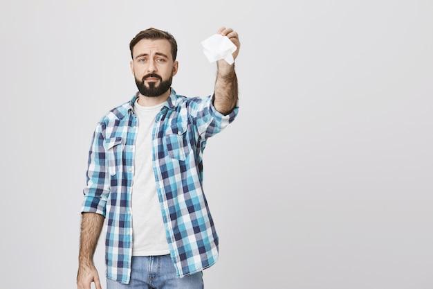 Sad adult man waving tissue saying goodbye