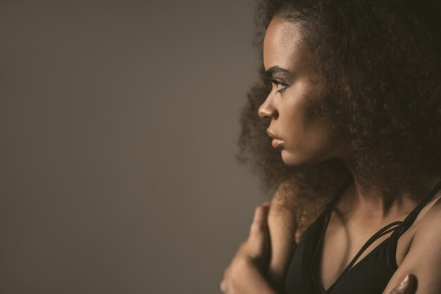 Sad african american girl standing in black top