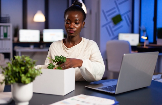 Sad african woman being fired during economy collapse, depressed, unhappy